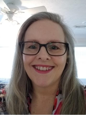 Smiling women with glasses. This is our member, Sheri